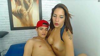 Latina girl breastfeeds boyfriend.