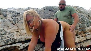 Picked up blonde MILF with big boobs is fucked outdoors by stud outdoors
