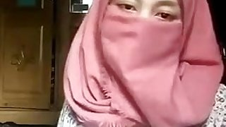 Hijab Muslim girl undressing