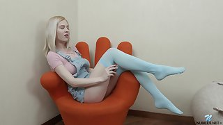 Hot and attractive blonde girl Avrora White plays with her sexy boobies