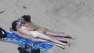 Horny couple at a nudist beach voyeur